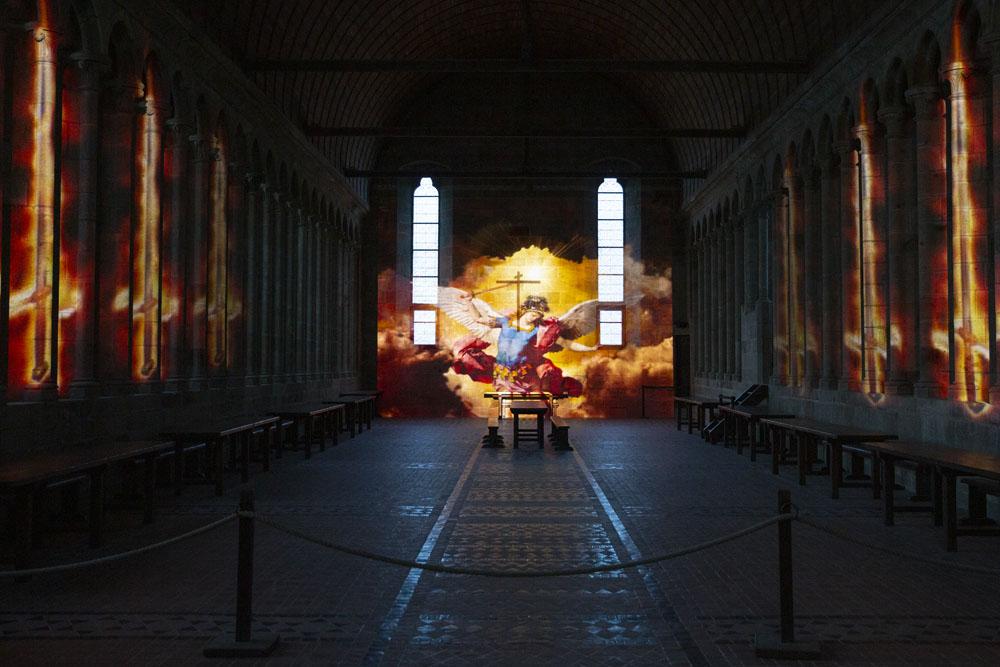 Klostret i Mont Saint-Michel - bildspel på väggen